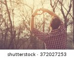 Hipster Guy Gesturing Heart...