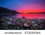sunset on the stone coast | Shutterstock . vector #372039364