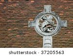 st george and dragon against a tiled roof background - stock photo