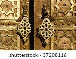brass gate with doorknockers....   Shutterstock . vector #37208116