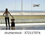 girl at the airport window... | Shutterstock . vector #372117076