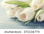 bouquet of white tulips on a...