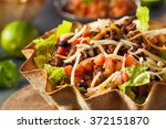 taco salad in a tortilla bowl... | Shutterstock . vector #372151870