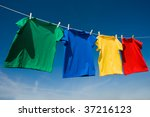 Stock photo a group of primary colored t shirts on a clothesline in front of blue sky 37216123