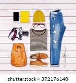 overhead of hipster woman... | Shutterstock . vector #372176140