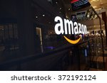 Small photo of SAN FRANCISCO - OCTOBER 11: Amazon logo on black shiny wall in mall California October 11, 2015. Amazon is a American international electronic commerce company and world's largest online retailer.