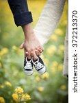 Future Parents Holding Hands...