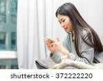 young woman using smart phone... | Shutterstock . vector #372222220