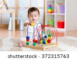 baby girl playing with... | Shutterstock . vector #372315763