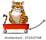 tiger sitting on the red wagon... | Shutterstock .eps vector #372325768