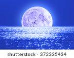 moonrise over ocean sea horizon.... | Shutterstock . vector #372335434