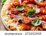 pizza with mozzarella  ham ... | Shutterstock . vector #372352939