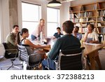 businesswoman addressing team... | Shutterstock . vector #372388213