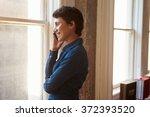 businesswoman using mobile... | Shutterstock . vector #372393520
