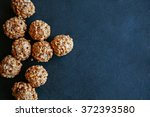 hazelnut pralines on black... | Shutterstock . vector #372393580