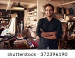 portrait of male owner standing ... | Shutterstock . vector #372396190