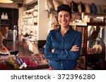 portrait of female owner... | Shutterstock . vector #372396280