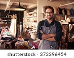portrait of male owner standing ... | Shutterstock . vector #372396454