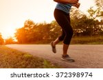 activity woman running on rural ... | Shutterstock . vector #372398974