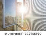 opened window on sunny day with ... | Shutterstock . vector #372466990