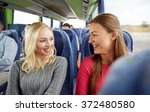 happy young women talking in... | Shutterstock . vector #372480580