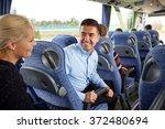group of happy passengers in...   Shutterstock . vector #372480694