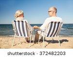 Happy Senior Couple In Chairs...