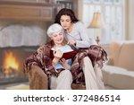 daughter and elderly mother... | Shutterstock . vector #372486514