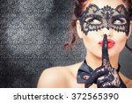 sexy woman with carnival mask.... | Shutterstock . vector #372565390