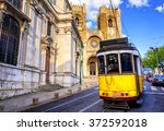 historical yellow tram in front ... | Shutterstock . vector #372592018