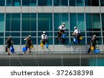 Team Of Climbing Workers...