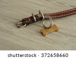 a worn out brown leather collar ... | Shutterstock . vector #372658660