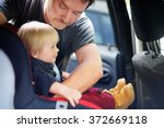 middle age father helps his... | Shutterstock . vector #372669118