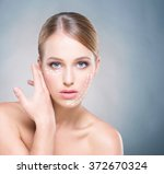 attractive woman with pure skin ... | Shutterstock . vector #372670324