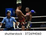 Small photo of BANGKOK - JAN 31: Khotchasan Phuket Drakon Muaythai (R) fights with Khrop Sut Fae Thek in thai boxing competition - Battle Of Petchwised at Rajadamnern stadium on January 31, 2016 in Bangkok.