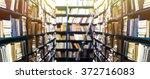 library bookshelves background | Shutterstock . vector #372716083