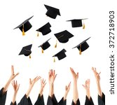 Graduates Hands Throwing...