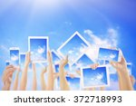 hands holding electronic... | Shutterstock . vector #372718993