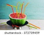 half of ripe watermelon and a... | Shutterstock . vector #372739459