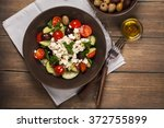 traditional greek salad with... | Shutterstock . vector #372755899