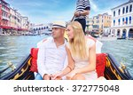 young happy couple swimming on... | Shutterstock . vector #372775048