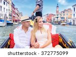 young happy couple riding on a... | Shutterstock . vector #372775099
