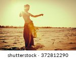beautiful girl dancing ethnic... | Shutterstock . vector #372812290
