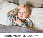 sick child boy lying in bed... | Shutterstock . vector #372820774