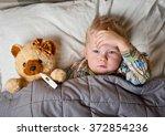 sick child boy lying in bed... | Shutterstock . vector #372854236