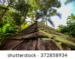stone pyramid roof at a green... | Shutterstock . vector #372858934