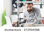 young designer engineer using a ... | Shutterstock . vector #372904588