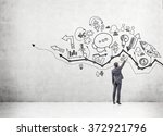 young businessman drawing many... | Shutterstock . vector #372921796