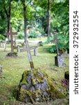 rusty cross at cemetery... | Shutterstock . vector #372932554