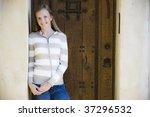 Tween Girl Standing In Doorway